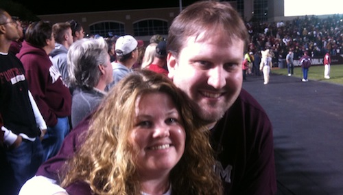 Scott and Tina posing in Kyle Field