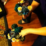 Beth arranging flowers as they're made